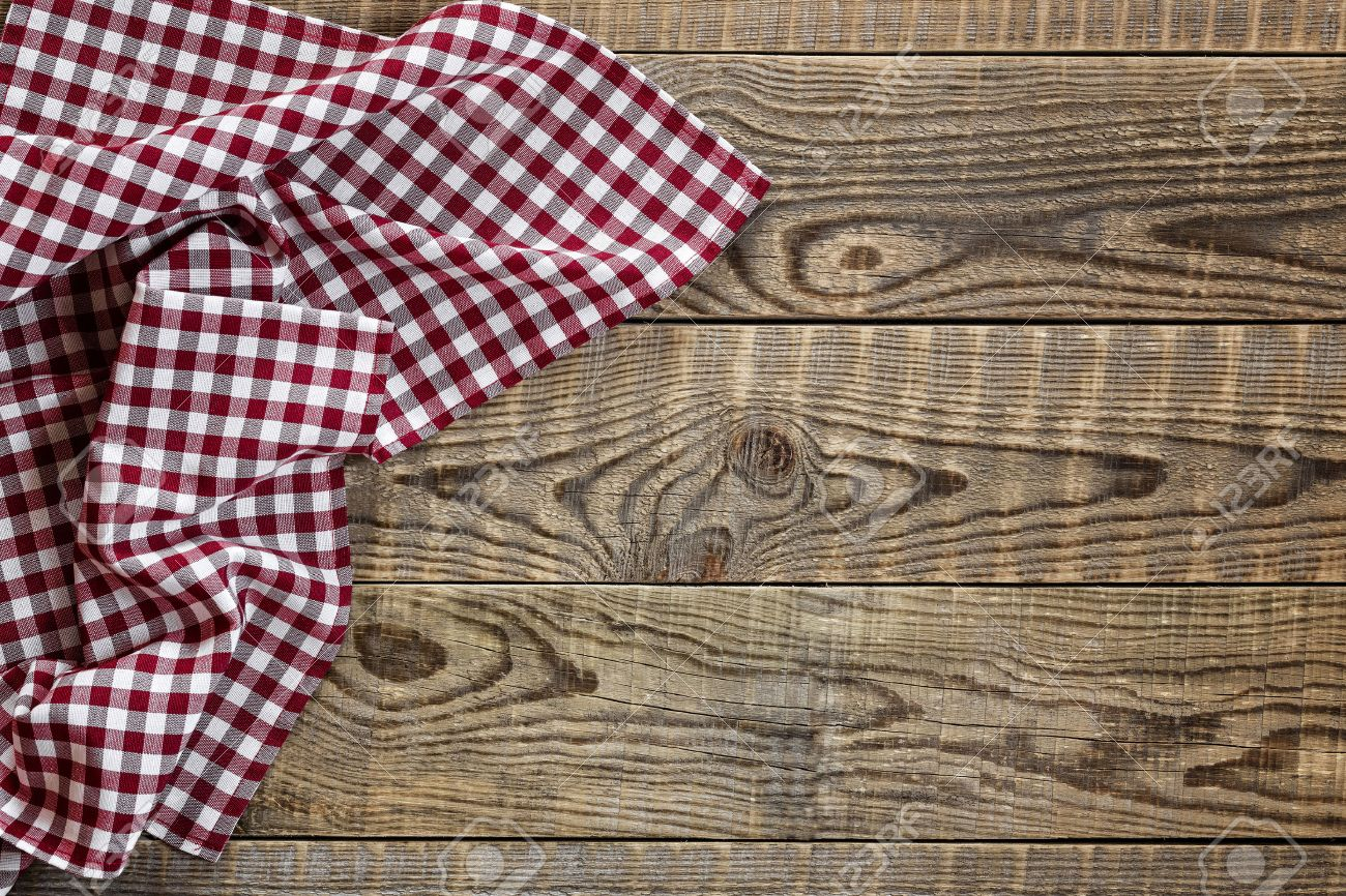 Empty wooden table with tablecloth - 30077459