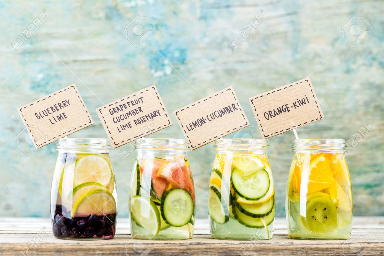 Variety of fruit infused detox water in jars for a healthy diet - 73185469