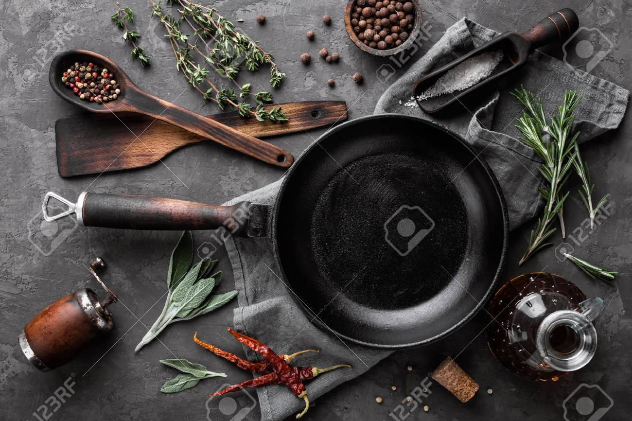 dark culinary background with empty black pan and space for text recipe or menu - 71732230