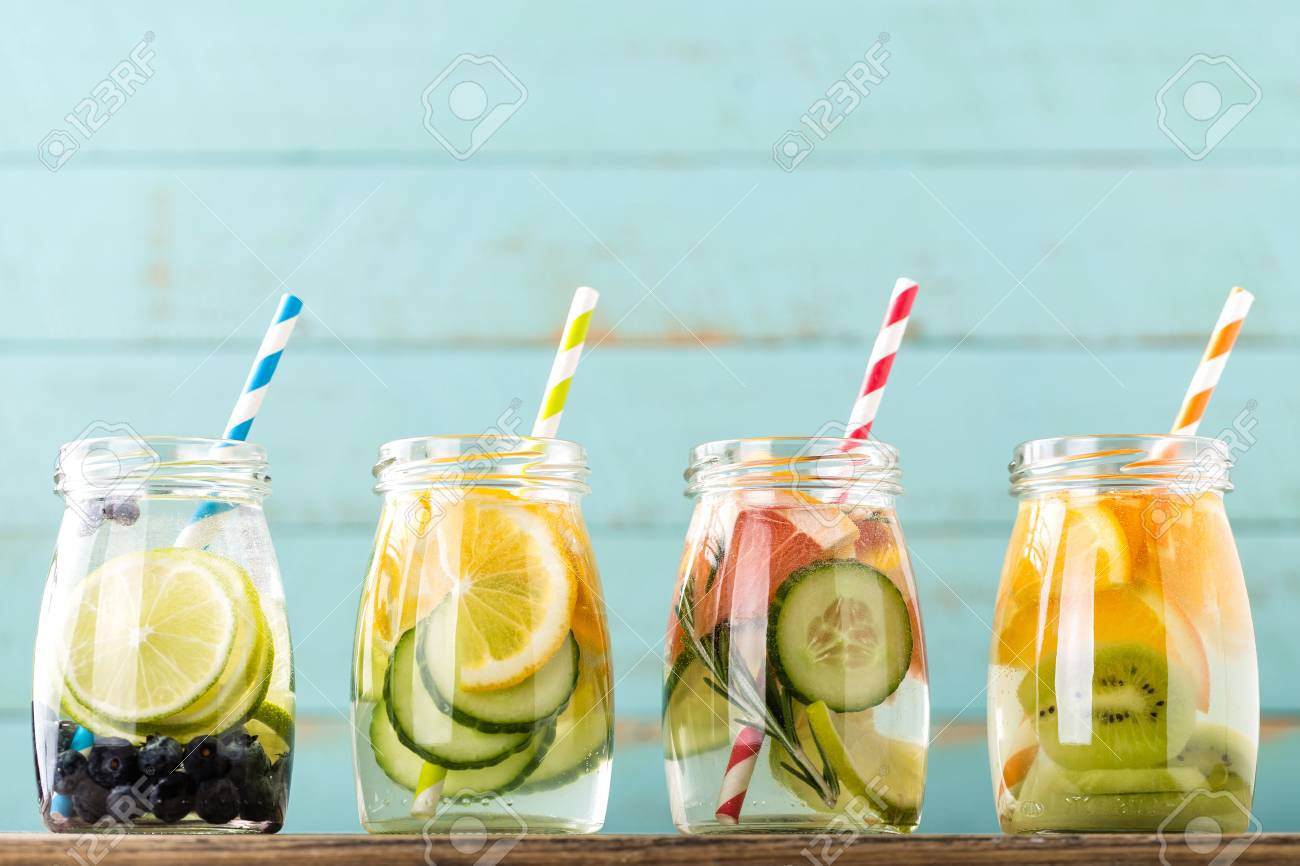 Variety of fruit infused detox water in jars for a healthy diet eating - 72813867