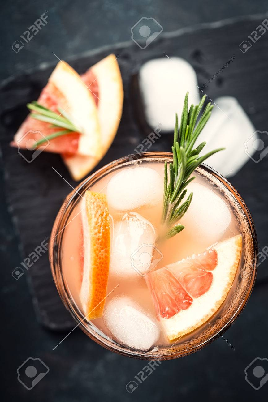 Grapefruit and rosemary gin cocktail or margarita, refreshing drink with ice - 73945714