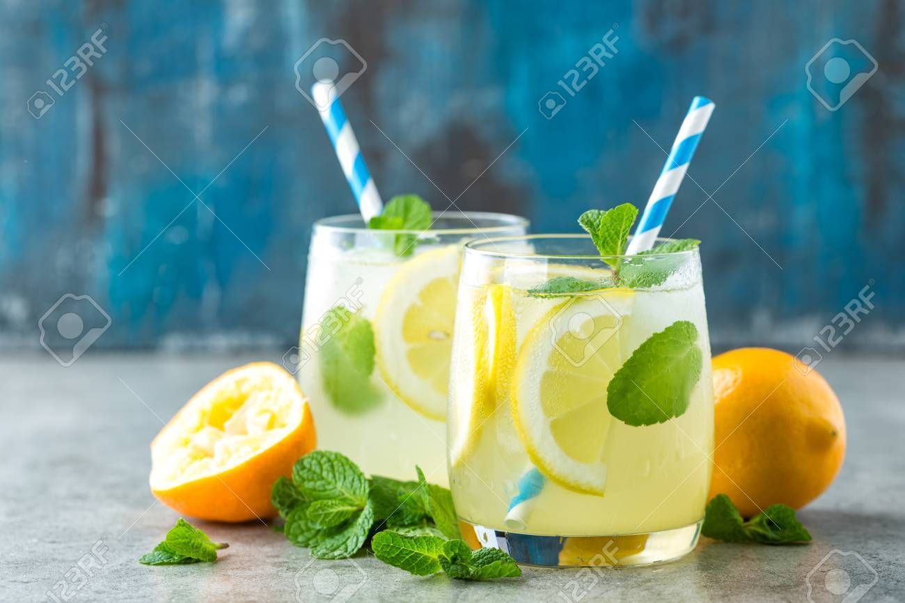 Lemonade or mojito cocktail with lemon and mint, cold refreshing drink or beverage with ice - 80678077