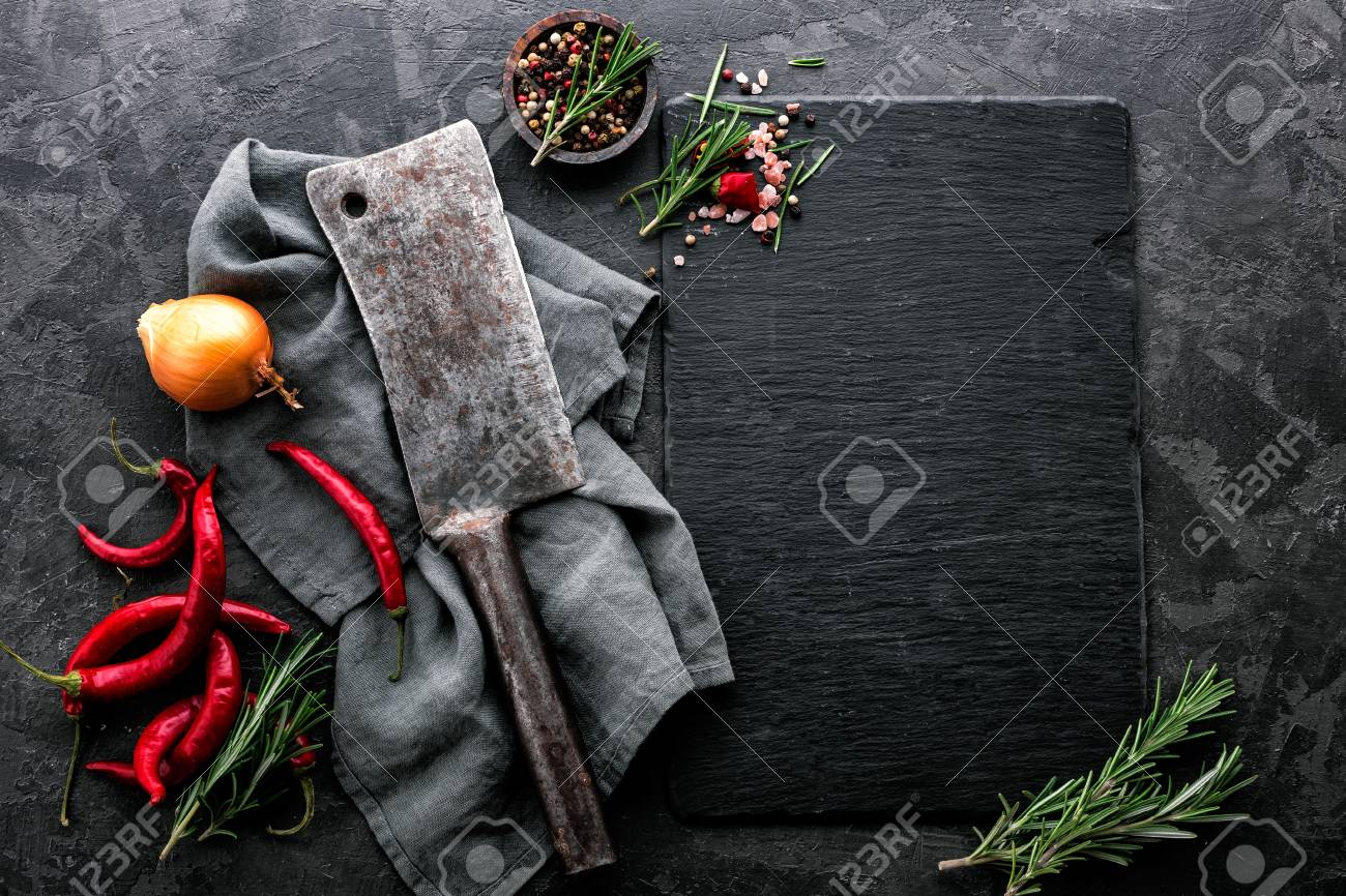 dark culinary background with empty black slate board and space for text recipe or meat menu - 93697240