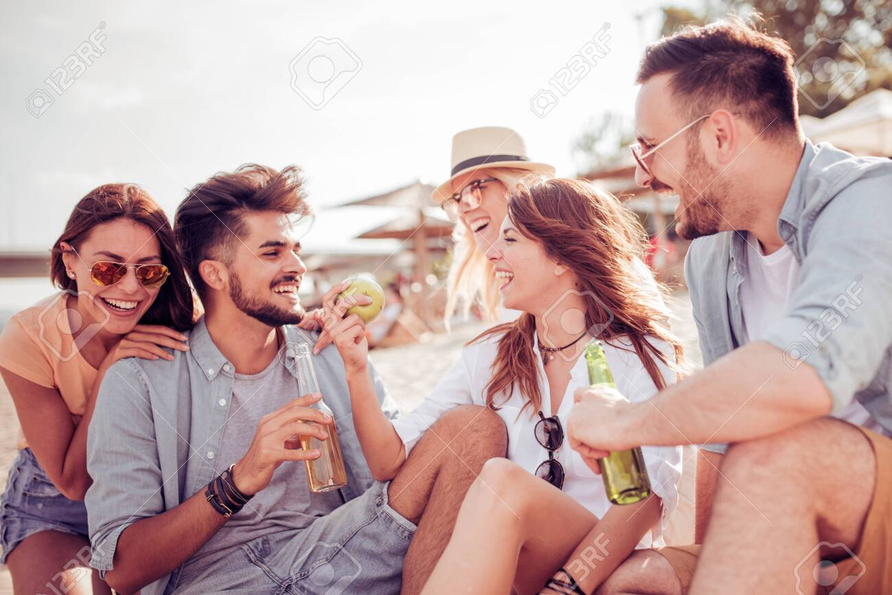 Group of cheerful young people relaxing on the beach. - 120246773