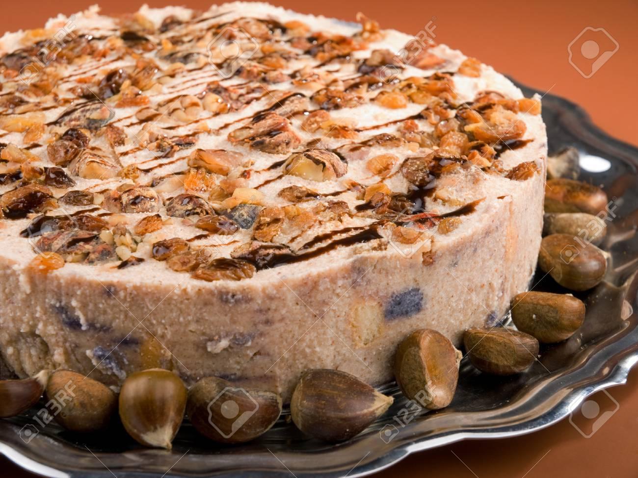 Chestnut and raisins tiramisu - prepared like standard tiramisu with the addition of pureed boiled chestnuts and raisins to the cream - 62251963