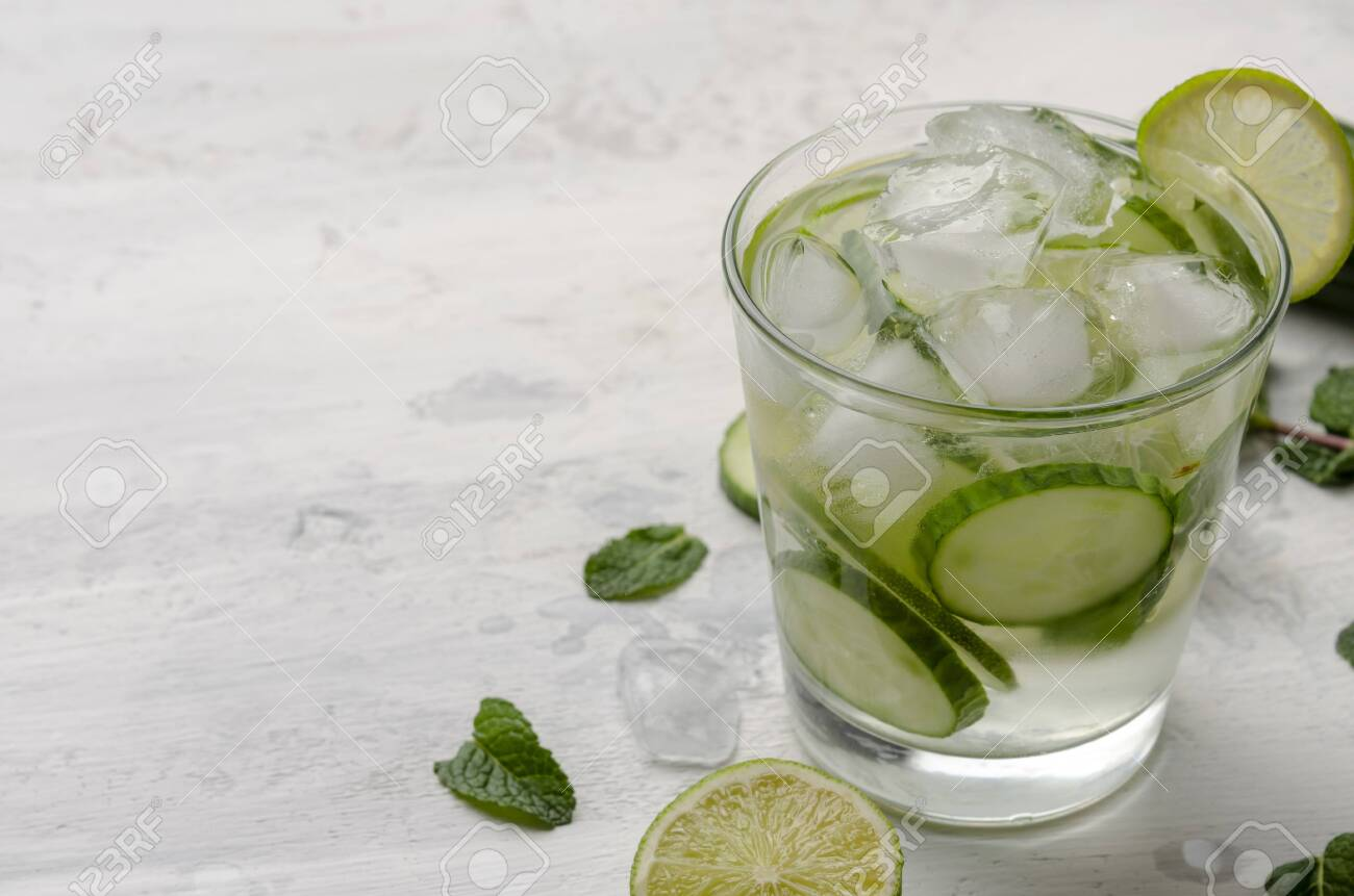 Infused water on a glass. Detox water mix of cucumber - 138246365