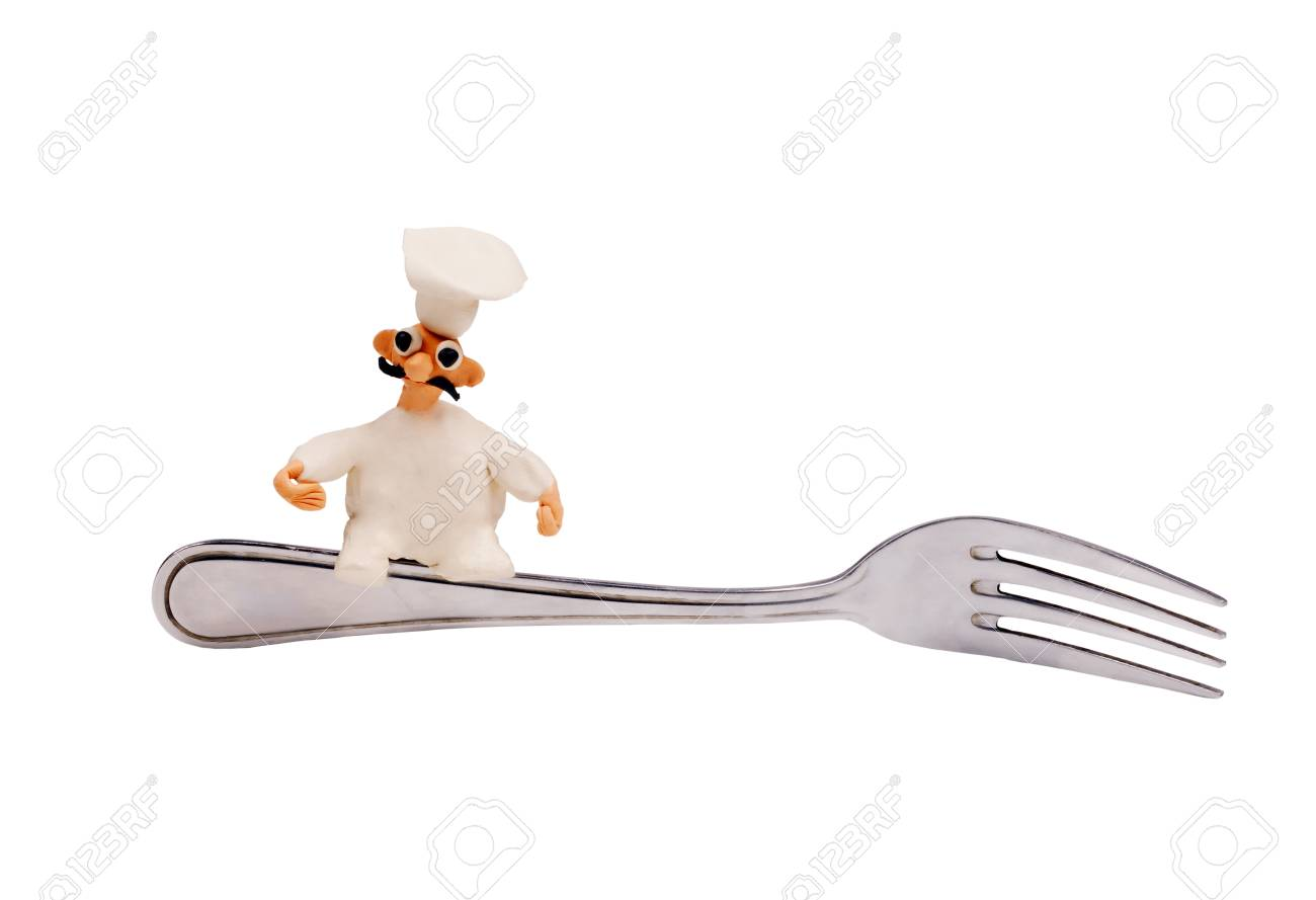 little cheerful chef made of plasticine sitting on a fork - 22458983