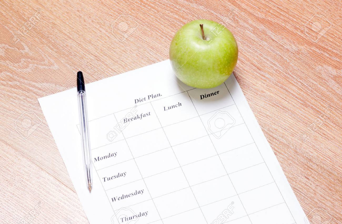 diet Plan. diet plan, pencil and apple lying on a wooden surface - 26083839