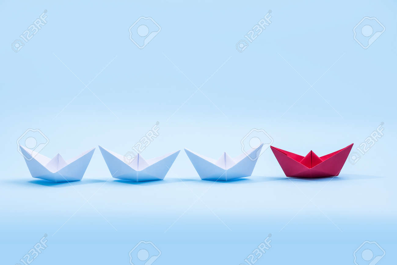 Red and white paper boats. Concept of leadership boats for teamwork group or success. - 159487962