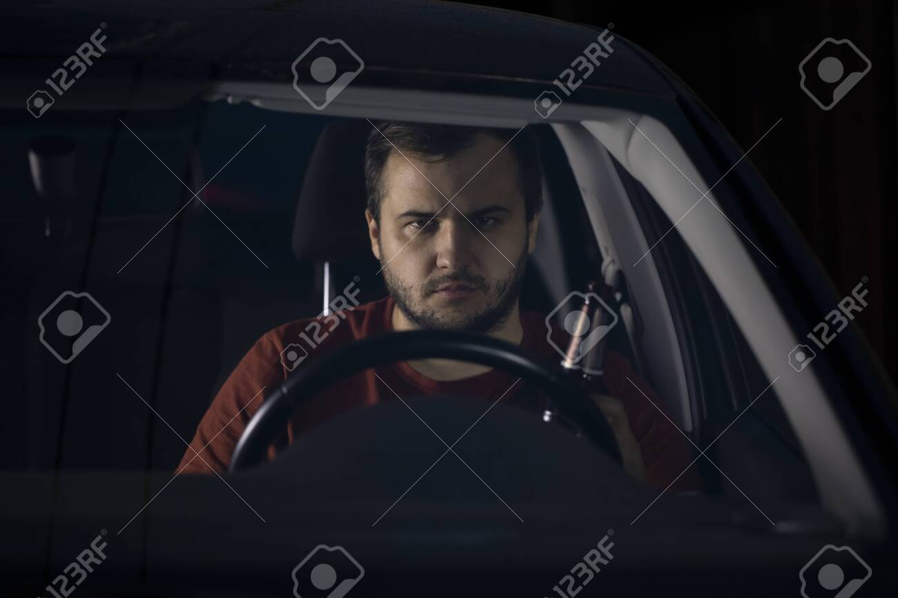 Portrait Of Handsome Young Man Driver Sits At Steering Wheel Stock Photo Picture And Royalty Free Image Image 150928638