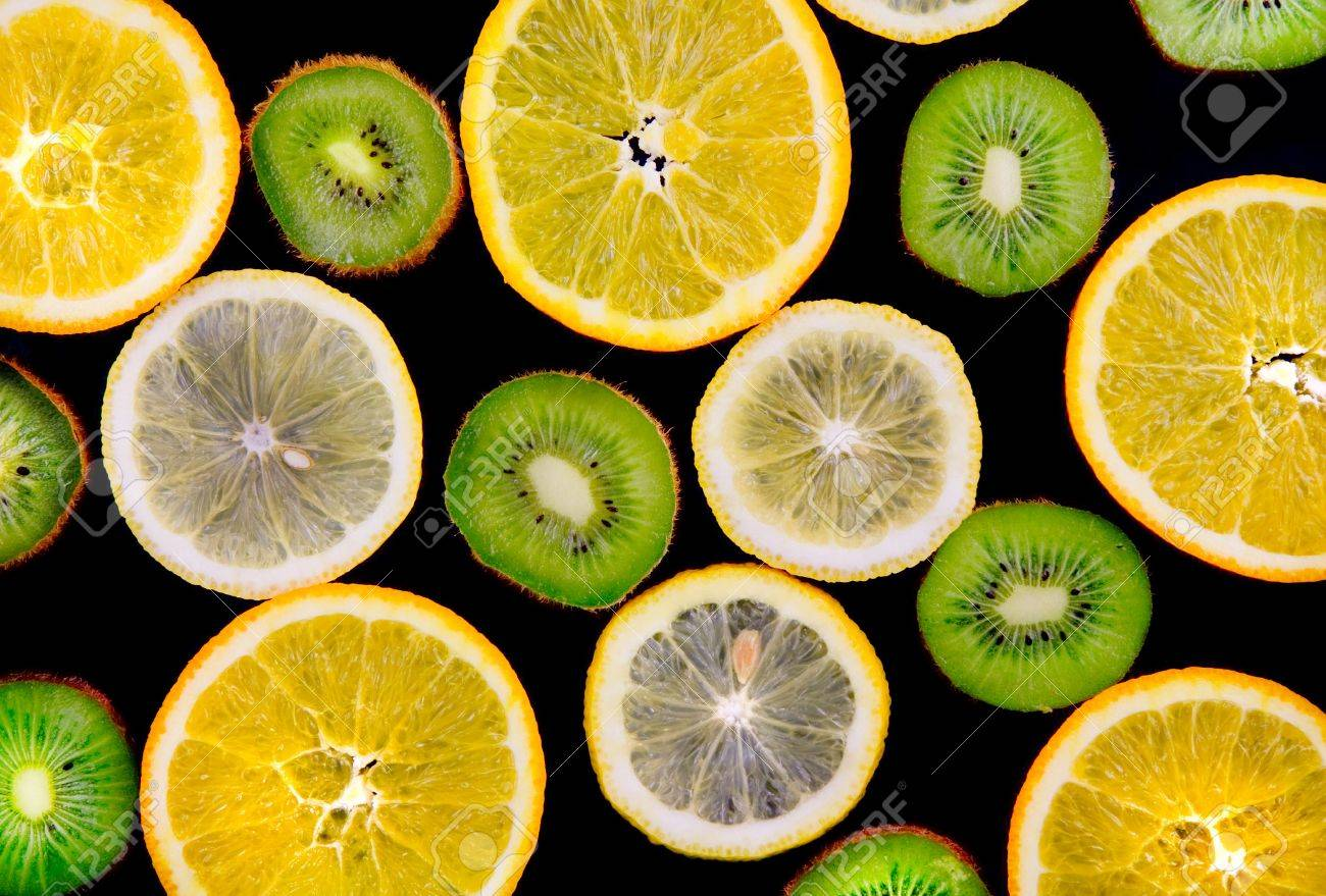 Background texture-fruit mix: lemon, orange, kiwi on black background. Stock Photo - 10276608