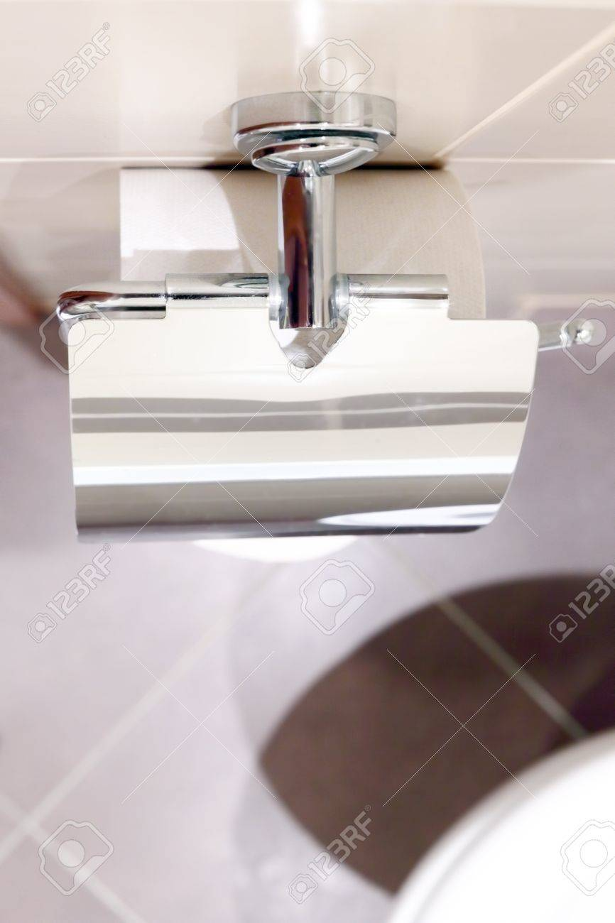 Roll of toilet paper holder in the toilet Stock Photo - 14714132