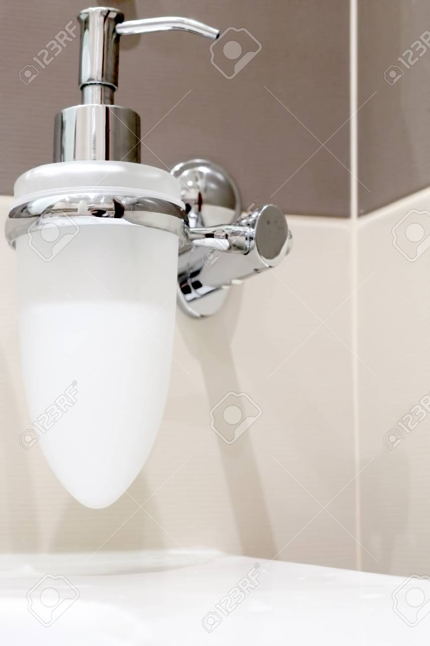 Faucet with soap dispenser in bathroom. Stock Photo - 14823571