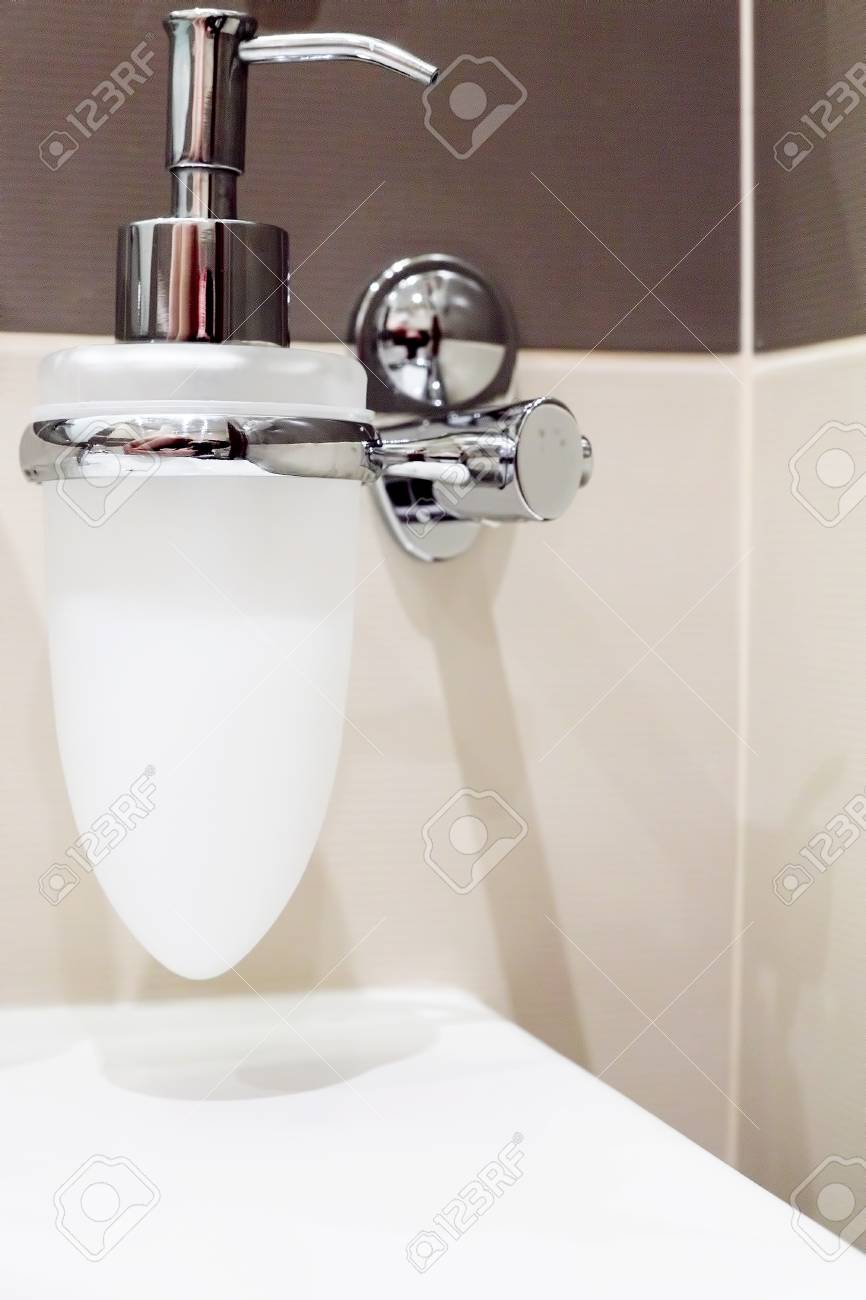 Faucet with soap dispenser in bathroom Stock Photo - 15501601