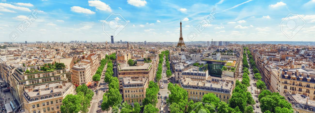 Beautiful panoramic view of Paris from the roof of the Triumphal Arch. Champs Elysees and the Eiffel Tower. France. - 70204171