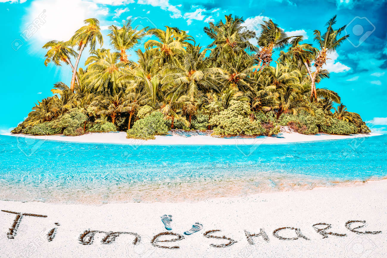 """Whole tropical island within atoll in tropical Ocean. Uninhabited and wild subtropical isle with palm trees. Inscription """"TimeShare"""" in the sand on a tropical island, Maldives. - 168259173"""