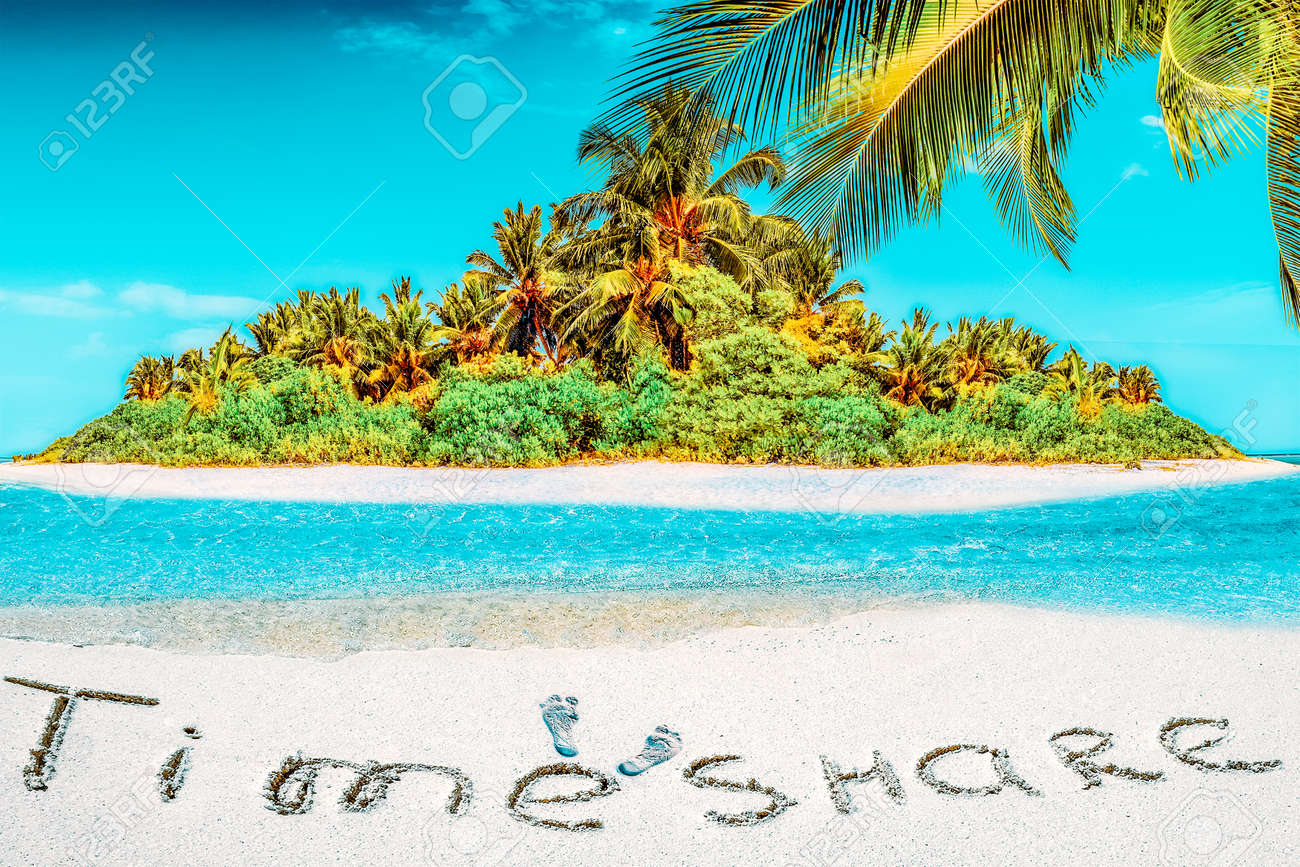"""Whole tropical island within atoll in tropical Ocean. Uninhabited and wild subtropical isle with palm trees. Inscription """"TimeShare"""" in the sand on a tropical island, Maldives. - 168259186"""
