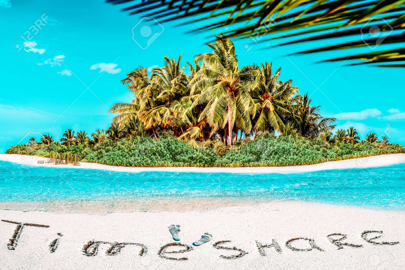 """Whole tropical island within atoll in tropical Ocean. Uninhabited and wild subtropical isle with palm trees. Inscription """"TimeShare"""" in the sand on a tropical island, Maldives. - 168259184"""