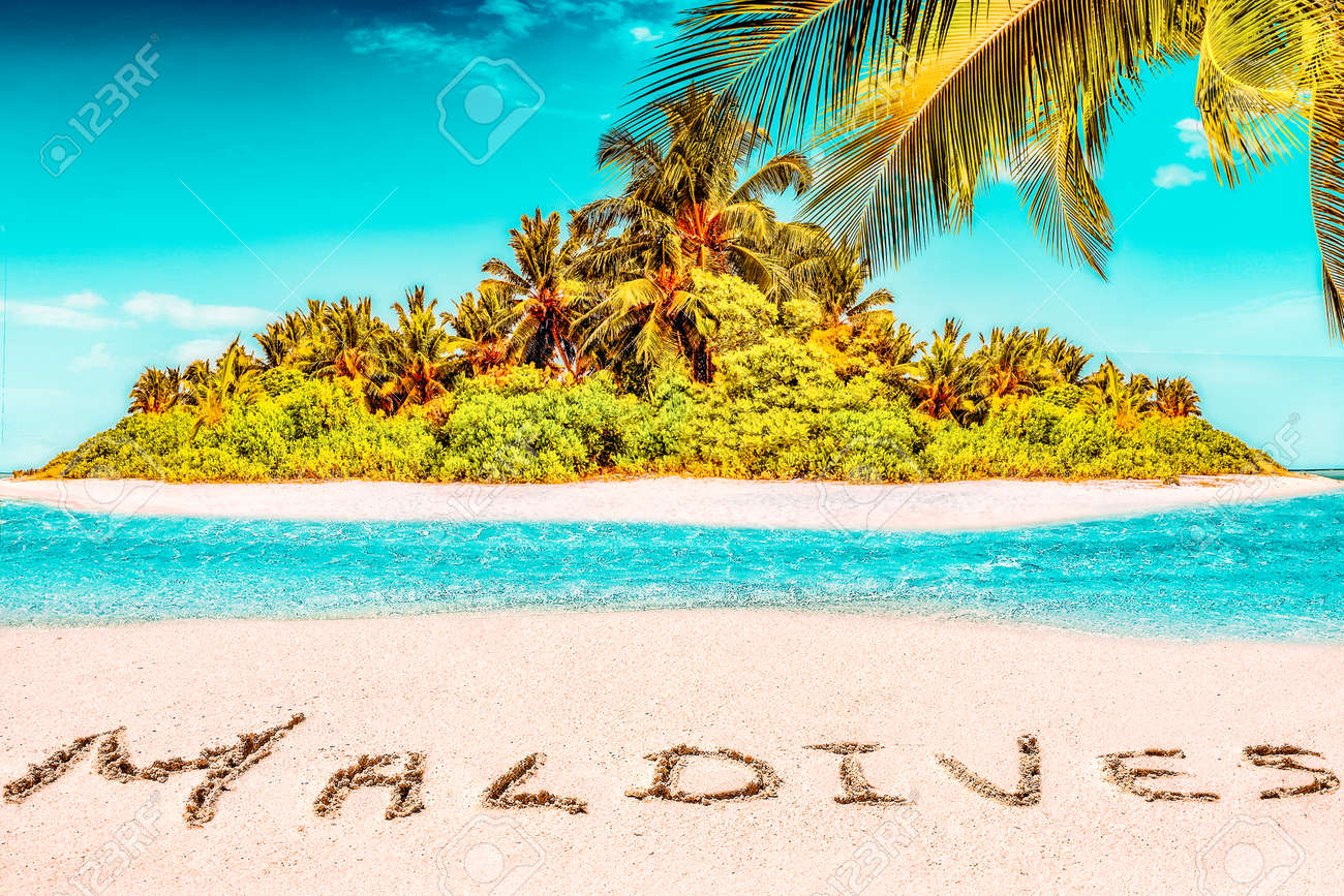 """Whole tropical island within atoll in tropical Ocean. Uninhabited and wild subtropical isle with palm trees. Inscription """"Maldives"""" in the sand on a tropical island, Maldives. - 168259298"""