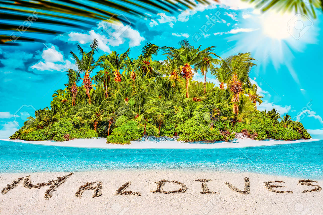 """Whole tropical island within atoll in tropical Ocean. Uninhabited and wild subtropical isle with palm trees. Inscription """"Maldives"""" in the sand on a tropical island, Maldives. - 168259299"""