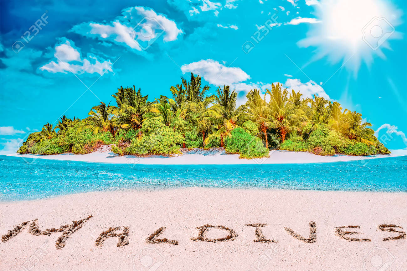 """Whole tropical island within atoll in tropical Ocean. Uninhabited and wild subtropical isle with palm trees. Inscription """"Maldives"""" in the sand on a tropical island, Maldives. - 168259313"""