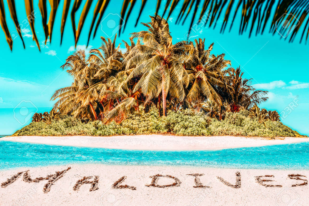 """Whole tropical island within atoll in tropical Ocean. Uninhabited and wild subtropical isle with palm trees. Inscription """"Maldives"""" in the sand on a tropical island, Maldives. - 168259314"""