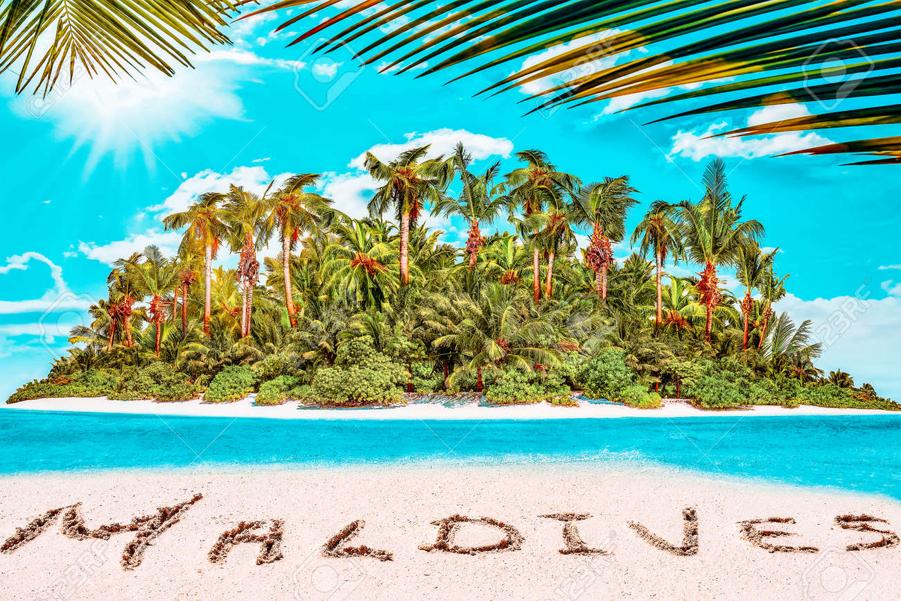 """Whole tropical island within atoll in tropical Ocean. Uninhabited and wild subtropical isle with palm trees. Inscription """"Maldives"""" in the sand on a tropical island, Maldives. - 168259331"""