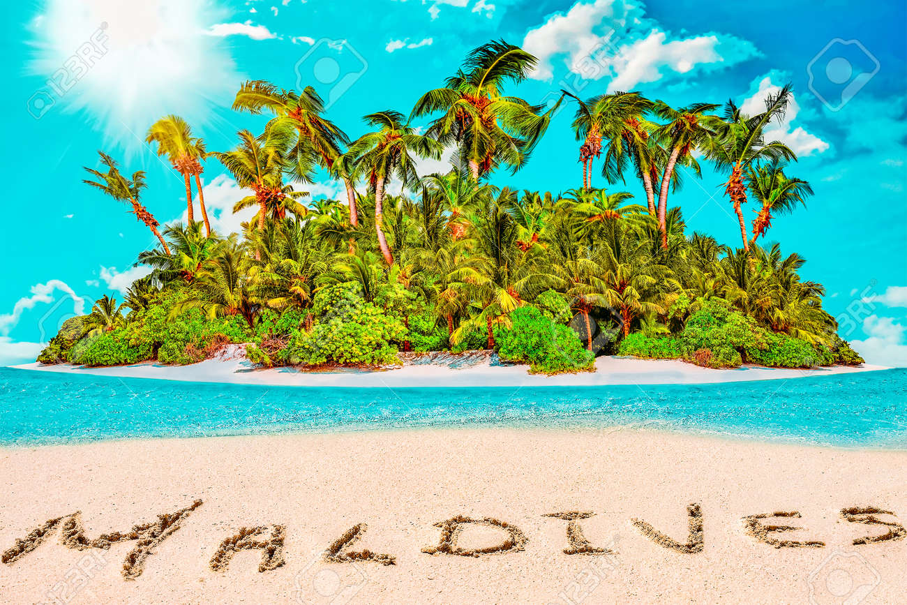 """Whole tropical island within atoll in tropical Ocean. Uninhabited and wild subtropical isle with palm trees. Inscription """"Maldives"""" in the sand on a tropical island, Maldives. - 168259332"""