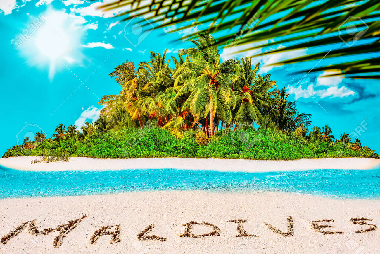 """Whole tropical island within atoll in tropical Ocean. Uninhabited and wild subtropical isle with palm trees. Inscription """"Maldives"""" in the sand on a tropical island, Maldives. - 168259334"""
