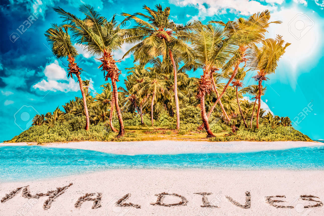 """Whole tropical island within atoll in tropical Ocean. Uninhabited and wild subtropical isle with palm trees. Inscription """"Maldives"""" in the sand on a tropical island, Maldives. - 168259340"""