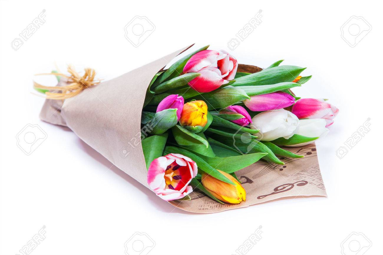 the bouquet of tulips is wrapped in a paper isolated on a white background - 52362855
