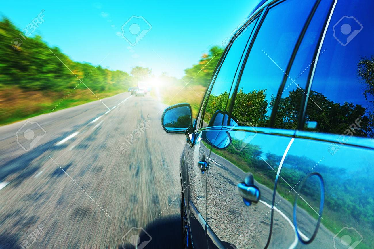 Blurred road and car, speed motion background - 52684410