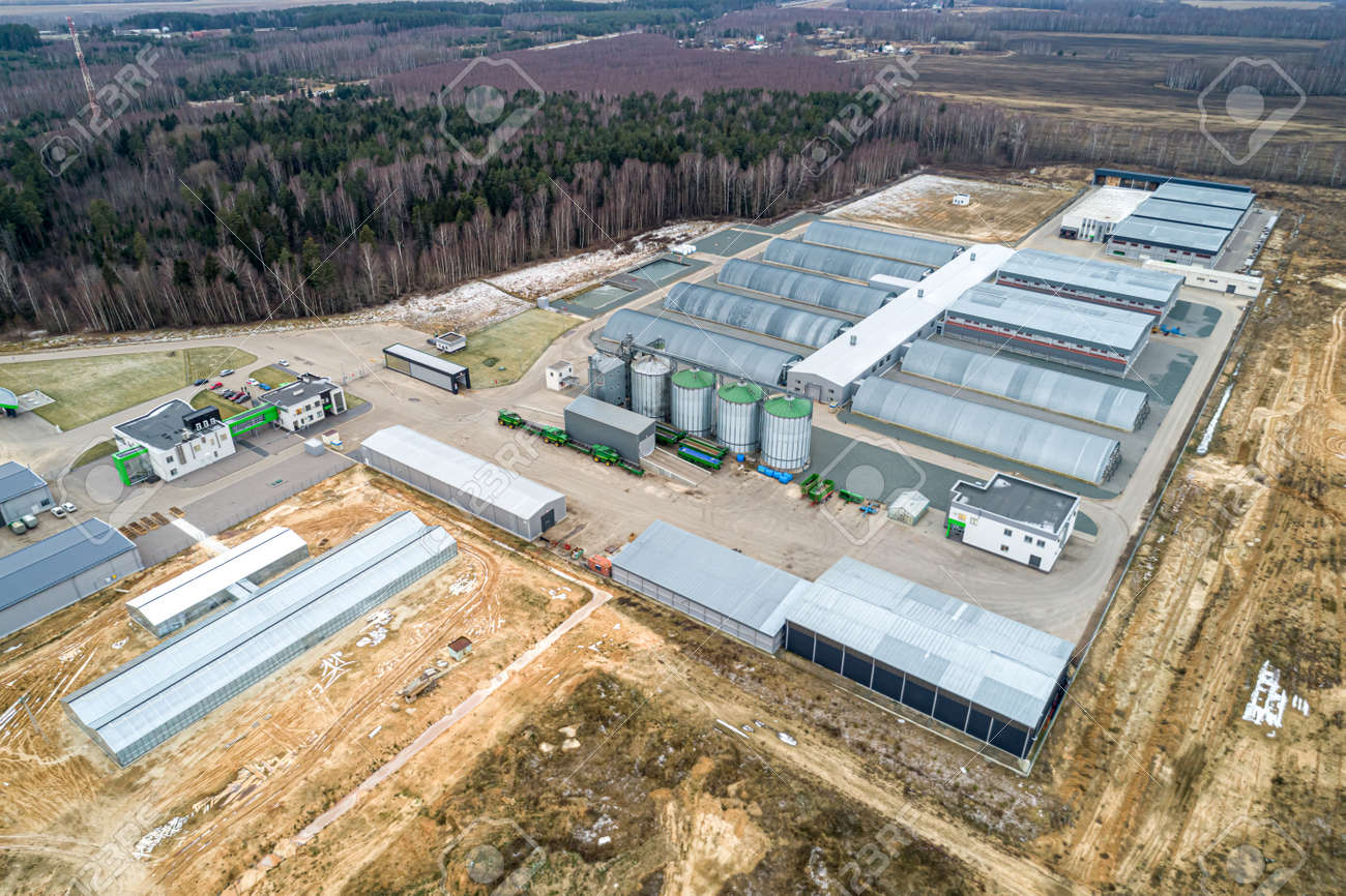 the modern agricultural sector. Top view, autumn. Metal hangars-vegetable stores - 158755431