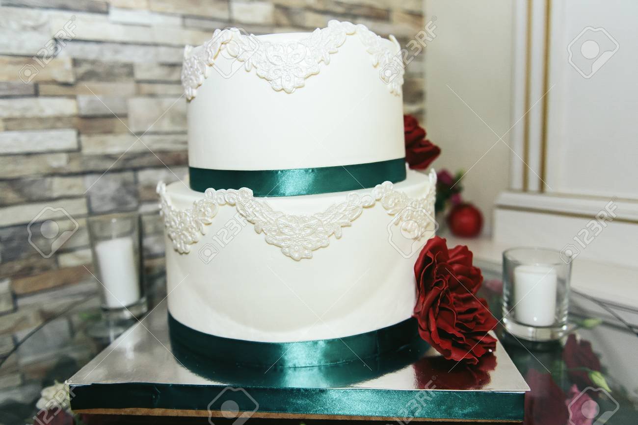 Wedding Cake With Green Ribbon And Red Flower Stock Photo, Picture ...