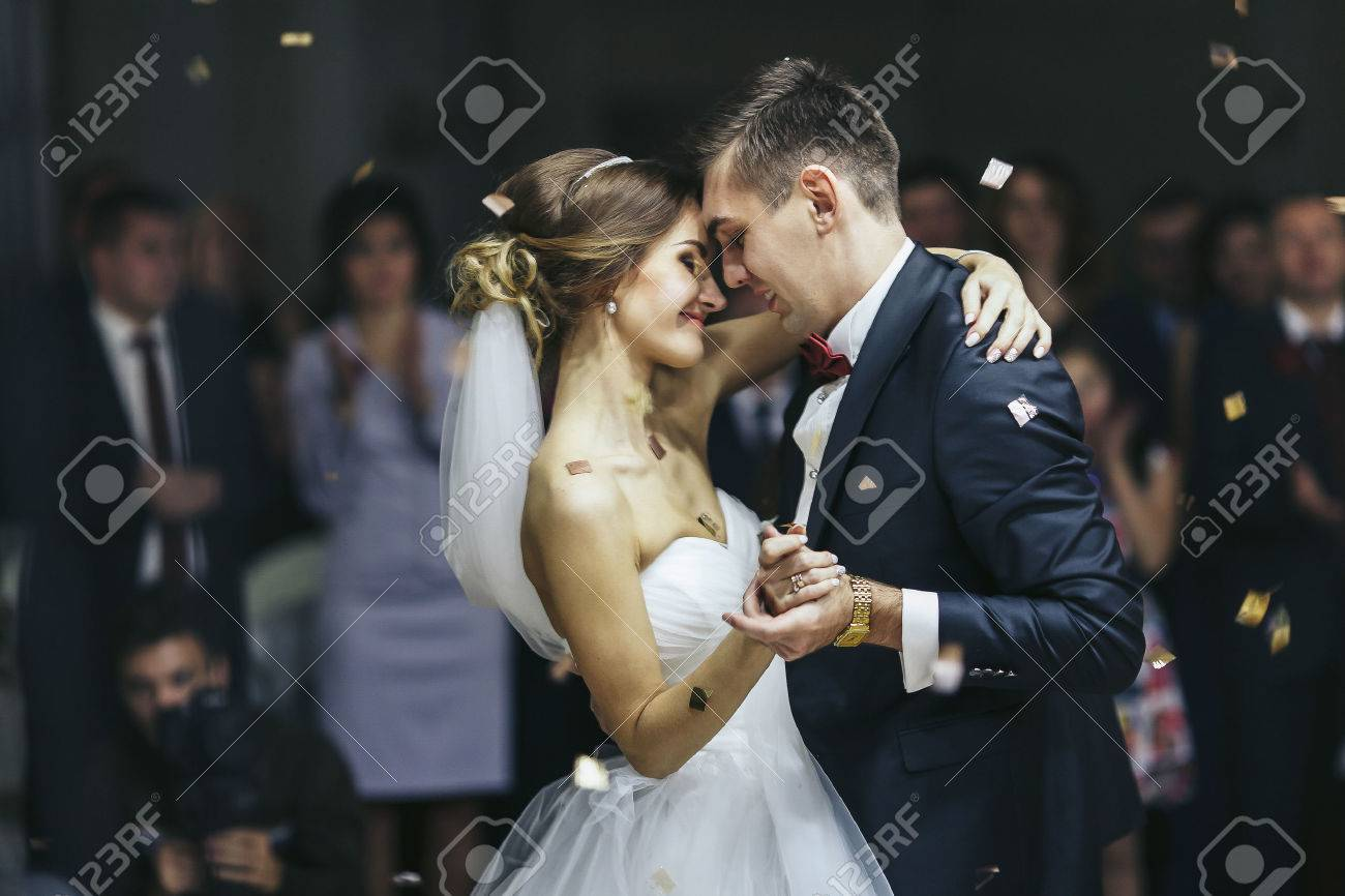 Just married looks romantically while dancing - 64224575