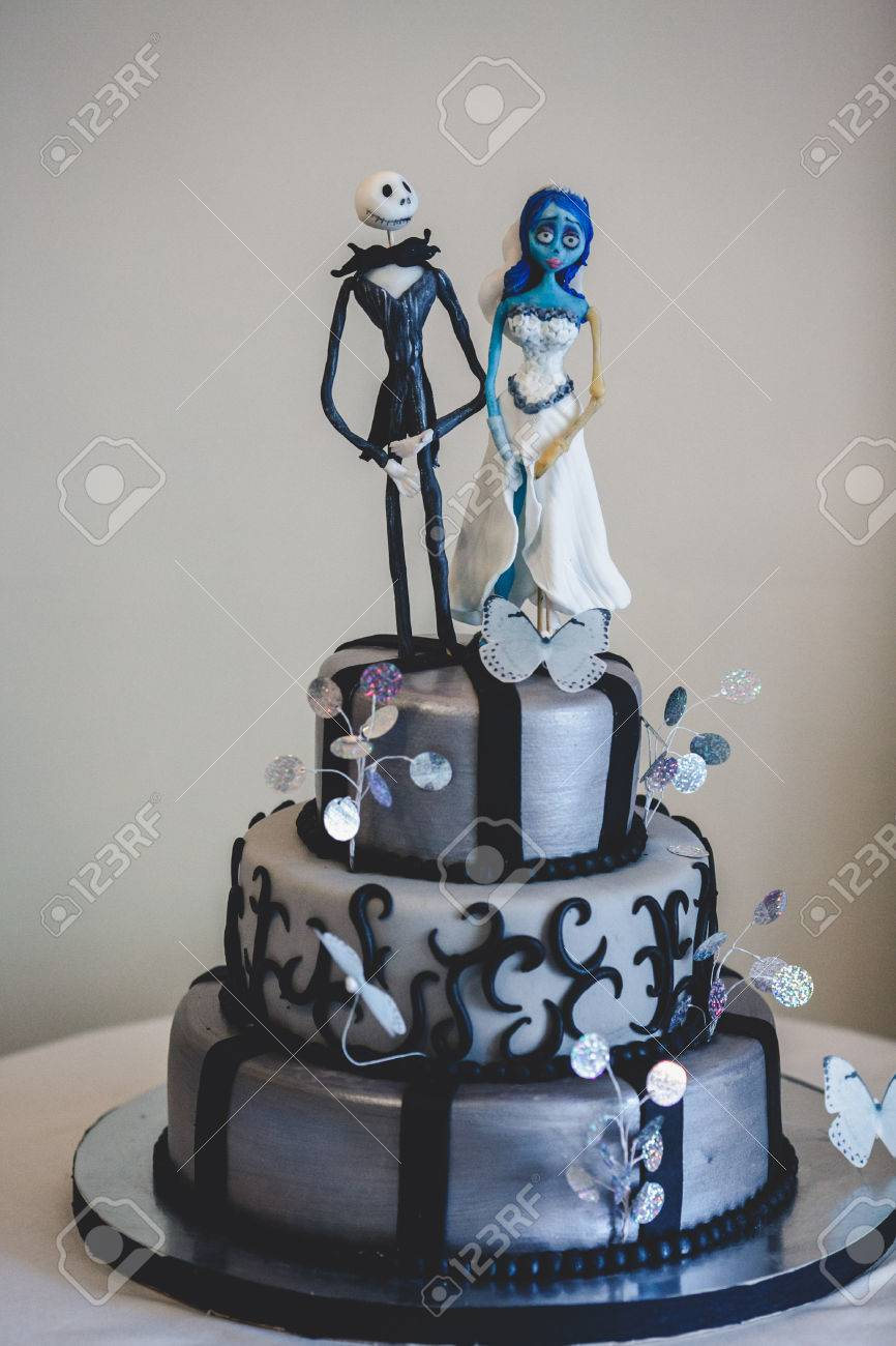 Black Gothic Wedding Cake Decorated With Figures Of Cartoon S