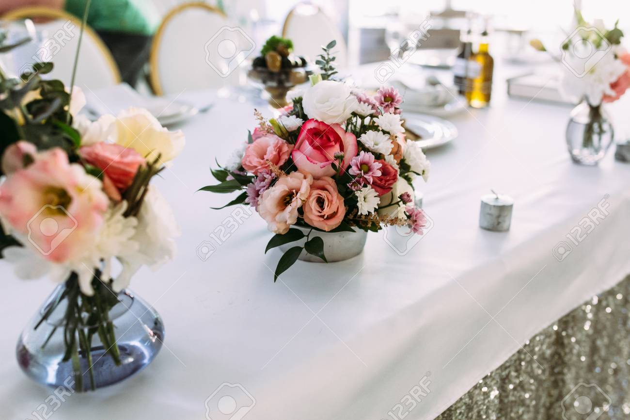 Cute Tiny Bouquet Of Flowers On The Table Stock Photo Picture And Royalty Free Image Image 65807362