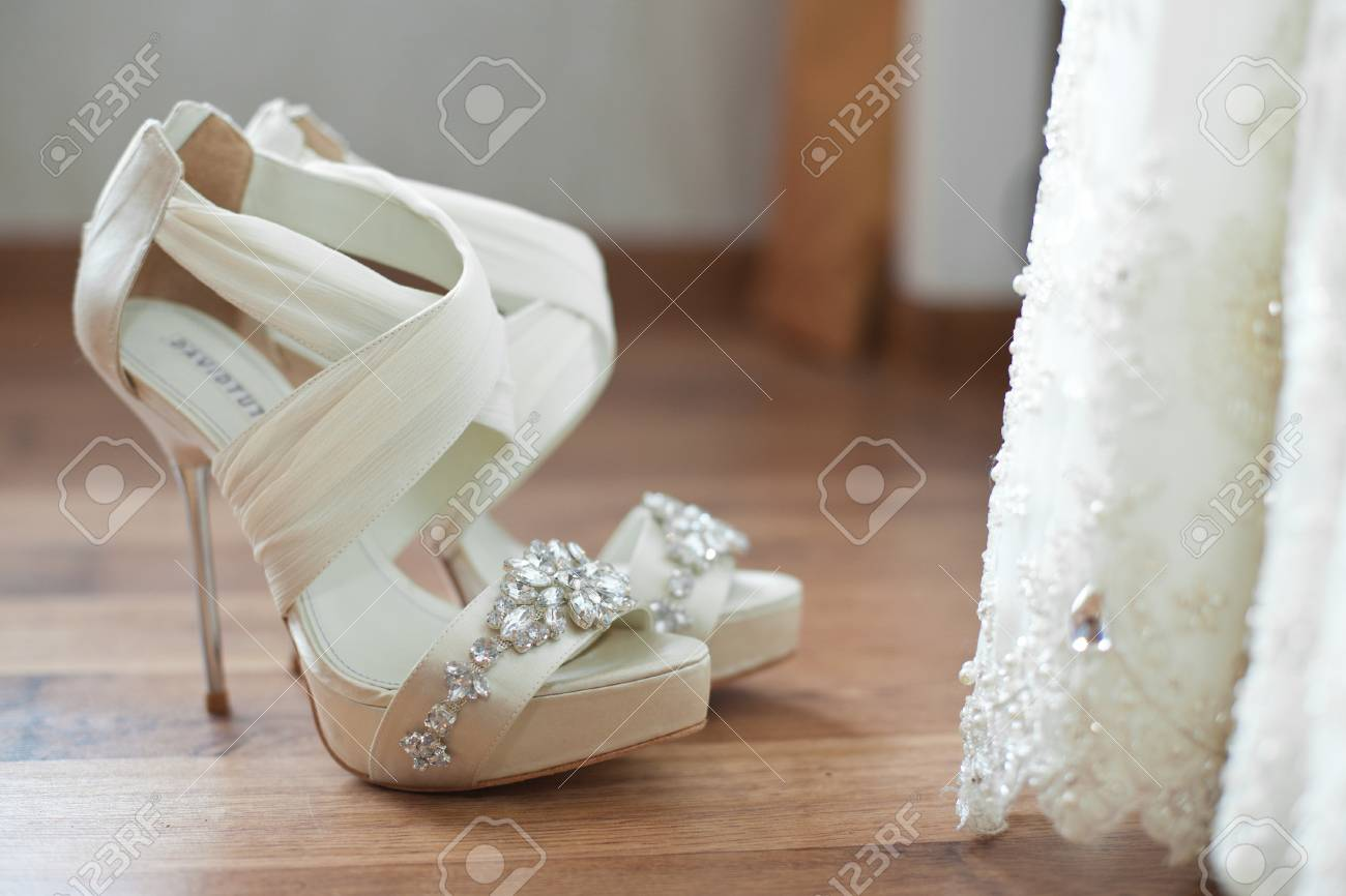 d4801bc1604 White Open Toe Wedding Shoes Decorated With Crystals Stock Photo ...