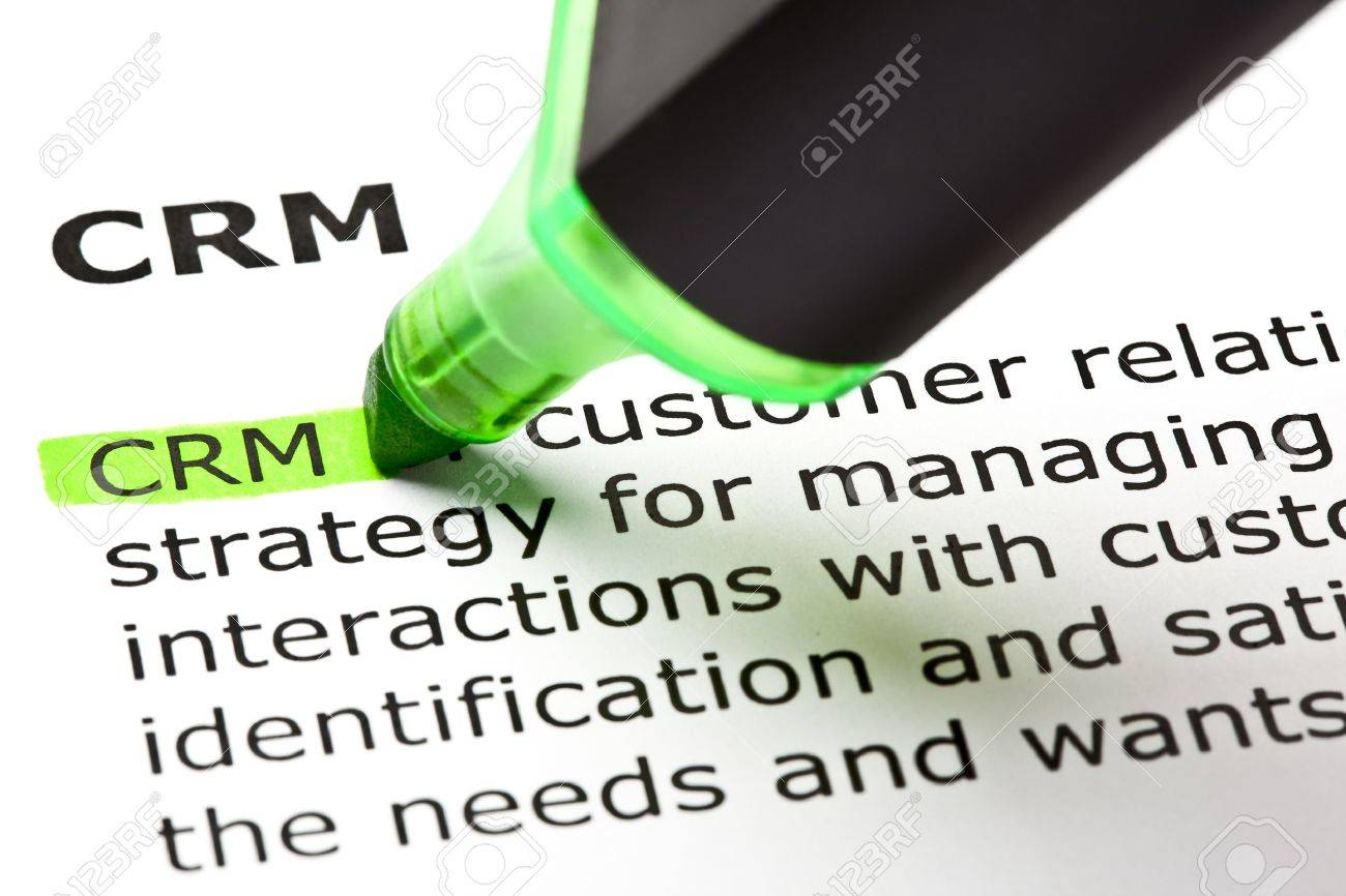 'CRM' - Customer relationship management, highlighted in green with felt tip pen Stock Photo - 9649133