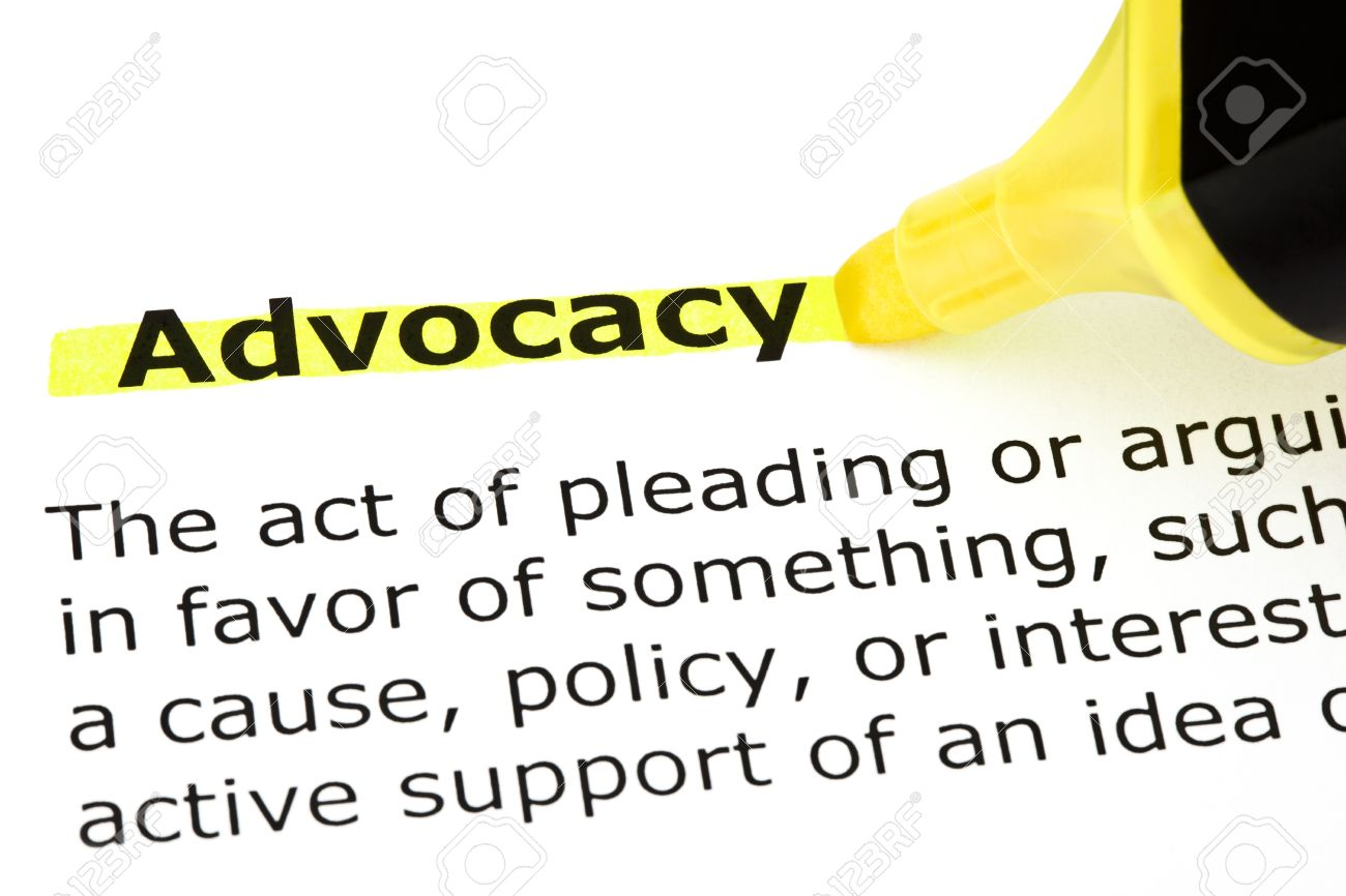 definition of advocacy highlighted with yellow felt tip pen stock