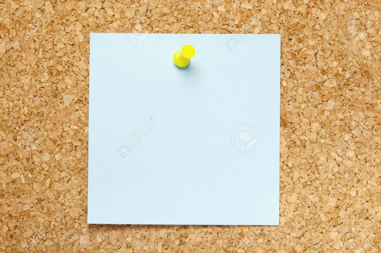 Cork Bulletin Board Blank Blue Sticky Note Pinned On A Cork Bulletin Board Stock