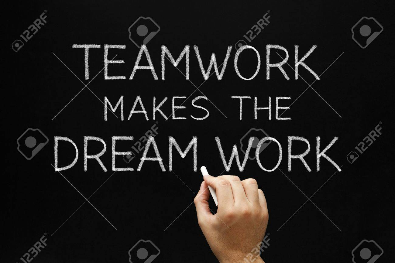 Hand writing Teamwork Makes The Dream Work with white chalk on a blackboard. Stock Photo - 18062156