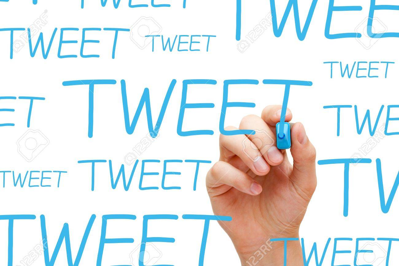 Hand writing Tweet with blue marker on transparent wipe board. Stock Photo - 18504942
