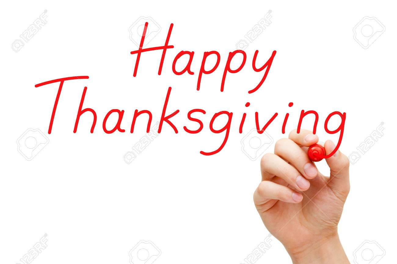 Hand writing Happy Thanksgiving with red marker on transparent wipe board. Stock Photo - 23840569