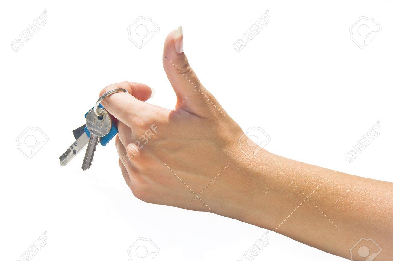 Thumb-up female hand holding a key bunch. Stock Photo - 10077639