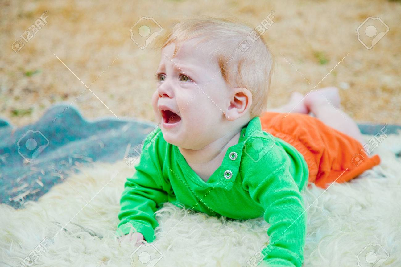 cute baby boy crying frantically stock photo picture and royalty