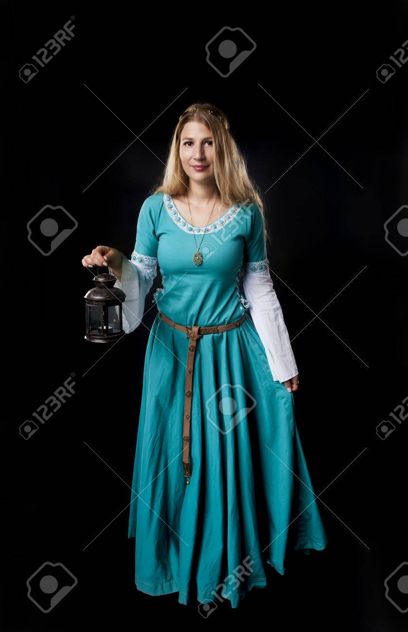 Studio Shot Of Beautiful Girl Dressed In A Medieval Turquoise ... for Girl Holding Lamp  113cpg