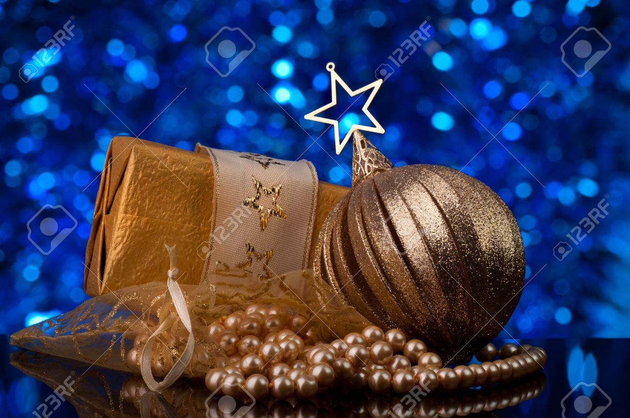 Blue and gold christmas decorations - Christmas Decorations In Gold Tones Defocused Blue Light In Background Stock Photo 8423821