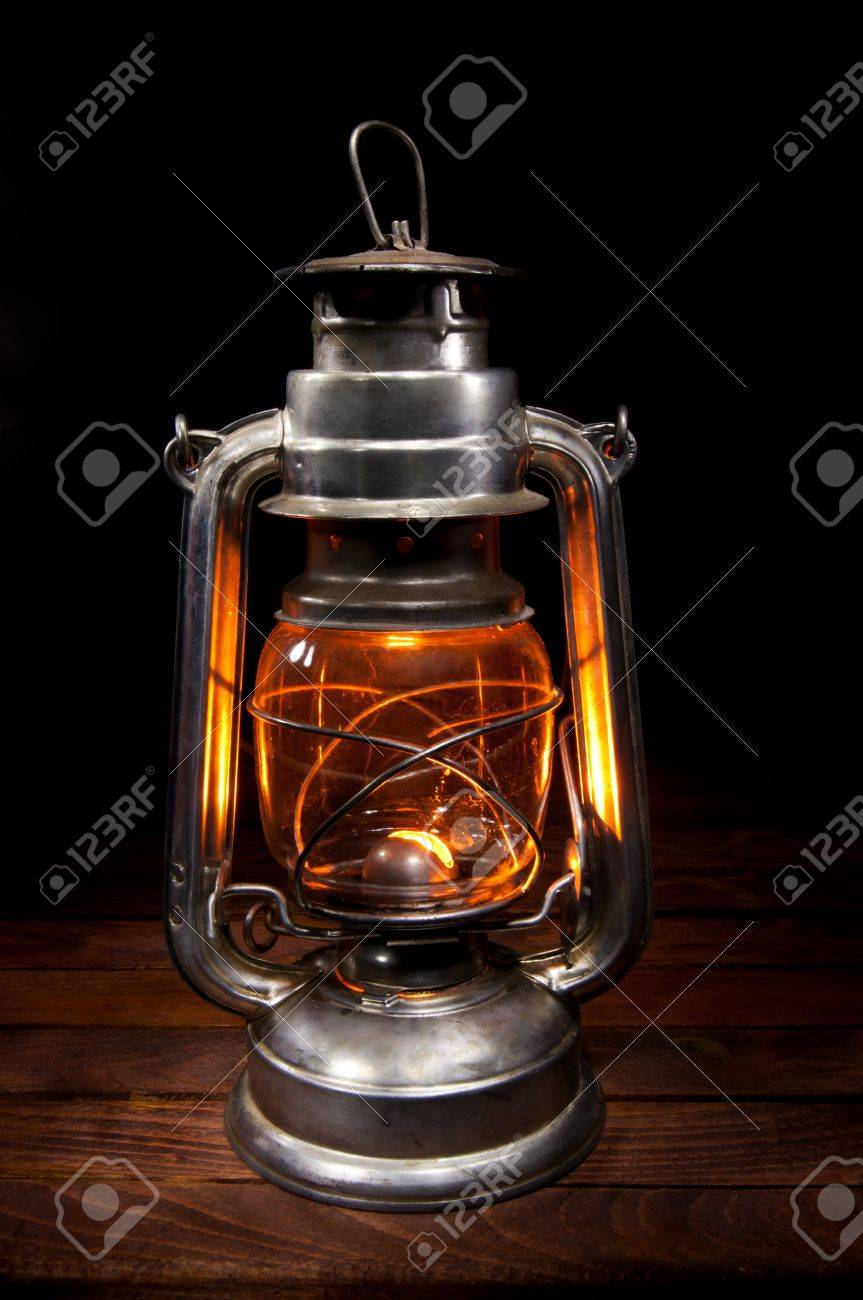 Antique Oil Lamp Lighting Up The Darkness Stock Photo, Picture And ...