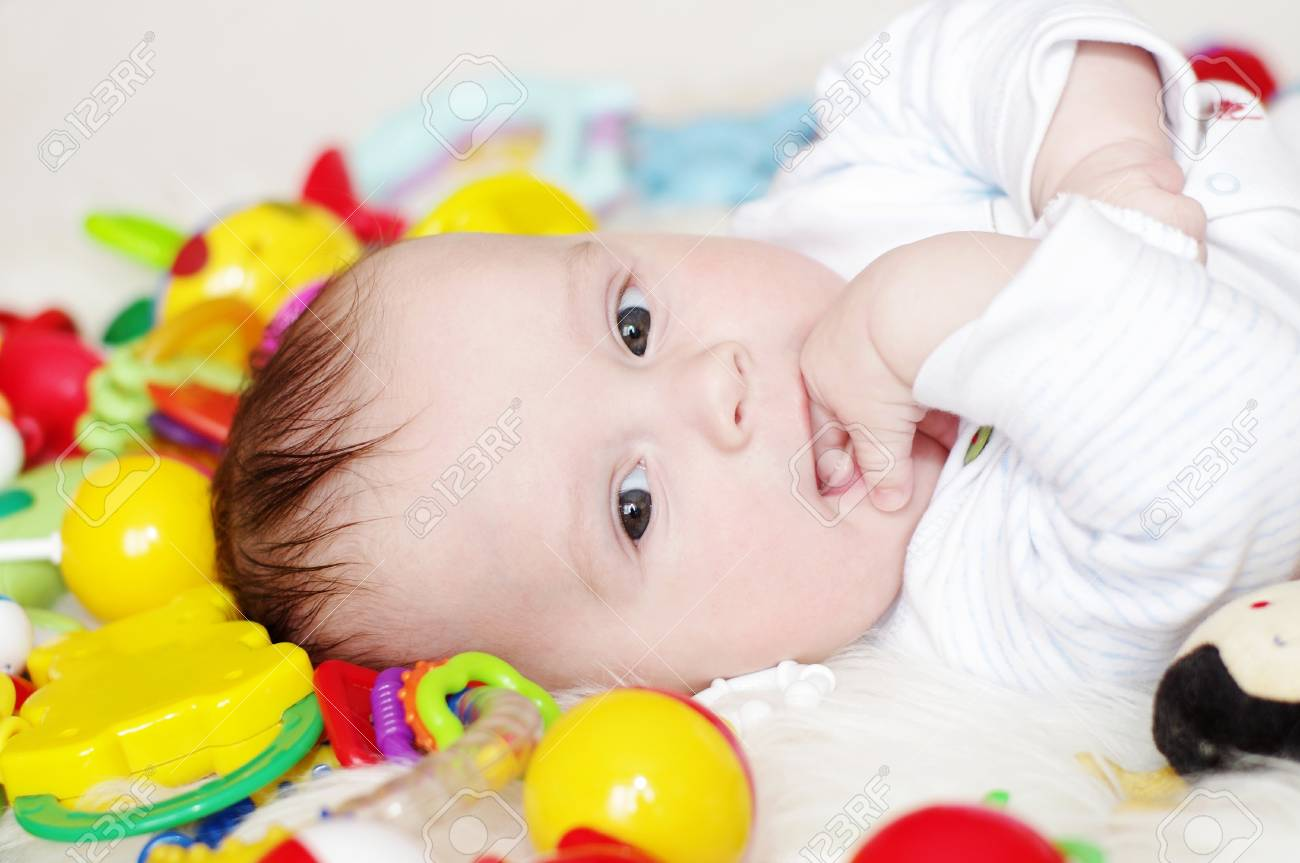 The happy baby lies among toys Stock Photo - 17452051